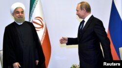 Russian President Vladimir Putin (right) greets Iranian President Hassan Rohani during a meeting in Baku in August 2016.