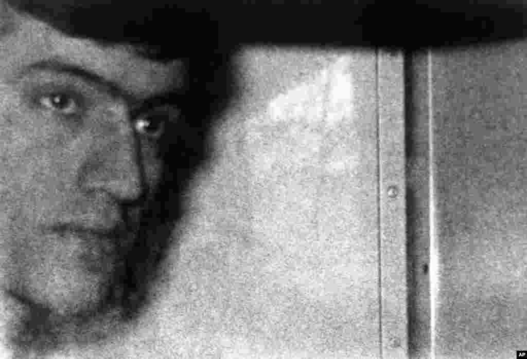 Fowzi Badavi-Negad is seen inside a police van arriving at Horseferry Road Magistrates Court in London on May 8, 1980. He had been an Iranian dock worker and was the only gunman to survive the embassy siege. Badavi-Nejad was given a life sentence in 1981. He was released in 2008 after a parole board concluded he was no longer a threat to society.