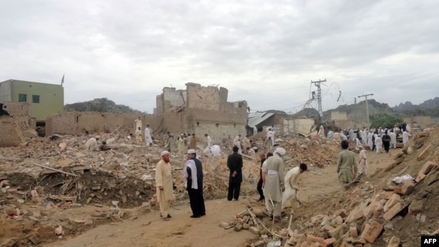 Local residents search for their belongings in the rubble of destroyed houses following a terrorist attack near a police station in the Lakki Marwat district of Khyber Pakhtunkhwa province in 2011.