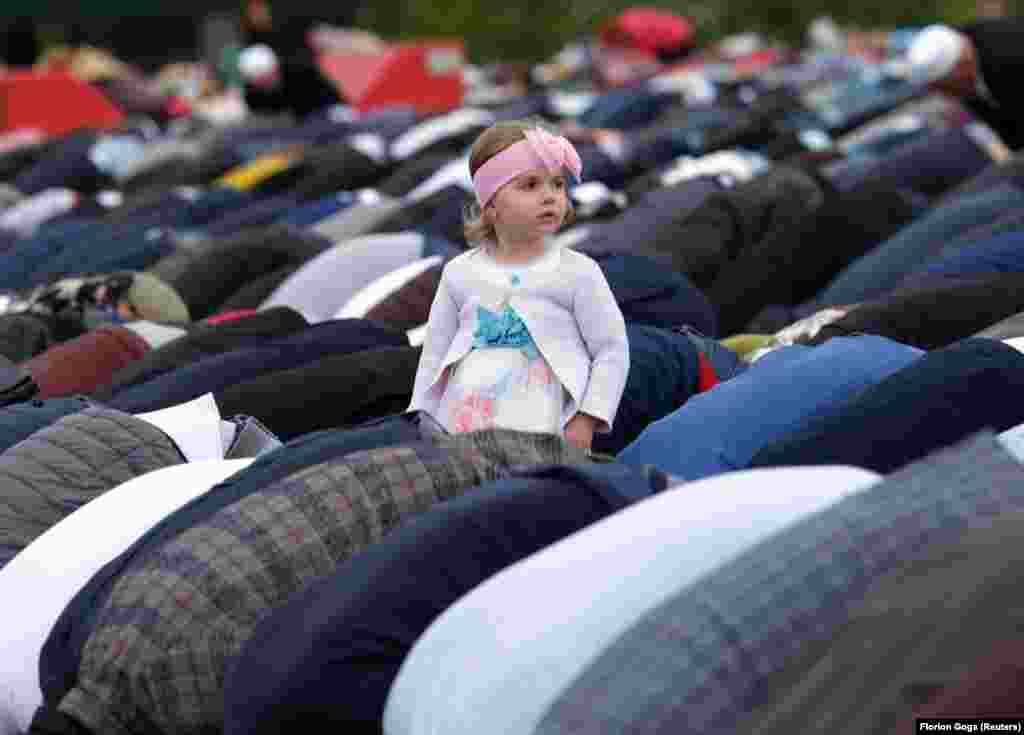 An Albanian girl attends the morning prayers of Eid al-Fitr, marking the end of the holy month of Ramadan in Skanderbeg Square, Tirana, on June 4. (Reuters/Florion Goga)