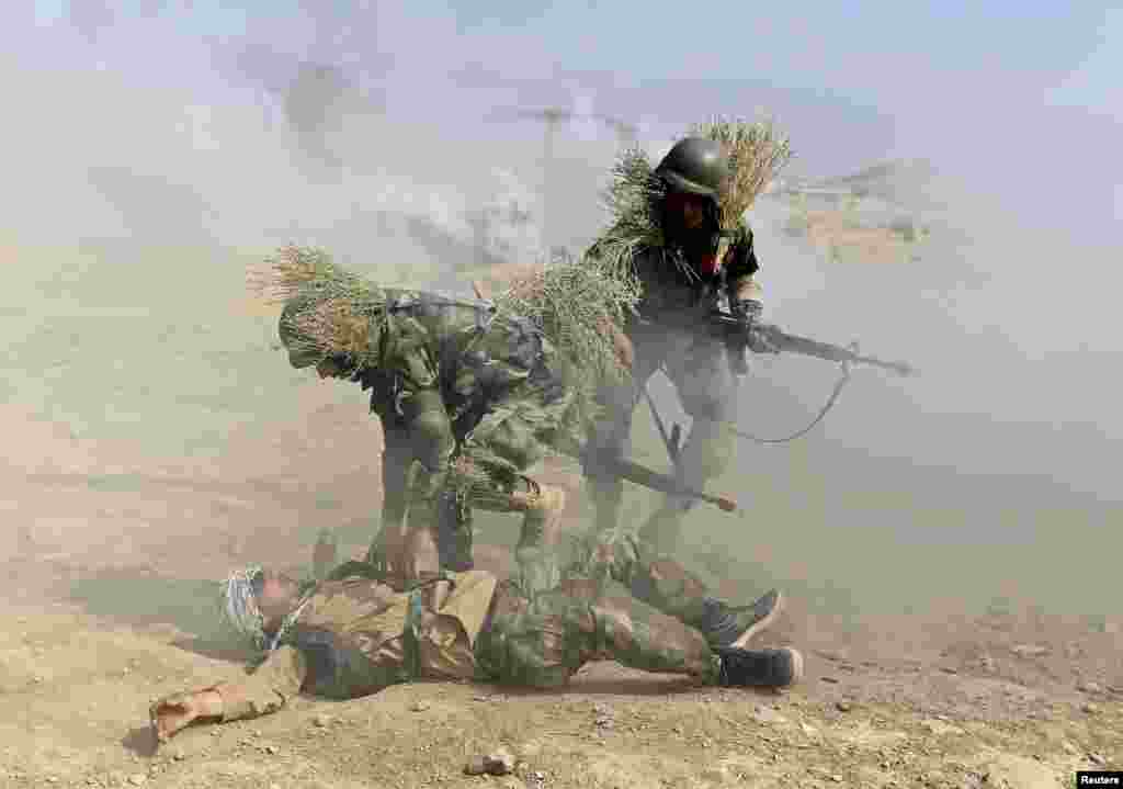Afghan National Army (ANA) officers take part in a training exercise at the Kabul Military Training Center (KMTC) in Kabul on October 8. (Reuters/Omar Sobhani)