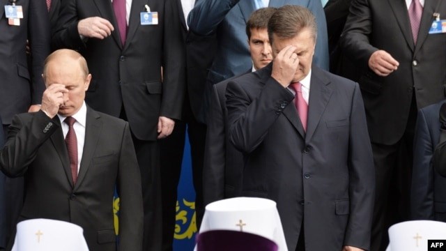 Russian President Vladimir Putin and former Ukrainian President Viktor Yanukovych during a 2013 ceremony in Kyiv marking the 1,025th anniversary of Christianity of Kievan Rus.