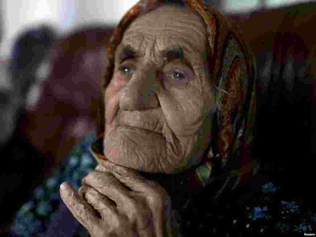 Chechen woman Kesi Karuyeva, whose official documents show she is the oldest person in the world at 116, sits inside her house in the village of Goity. (Photo by Diana Markosian for Reuters)