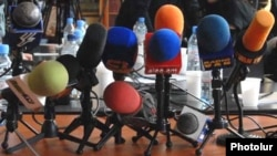 Armenia -- TV and radio microphones laid out during a news conference in Yerevan.