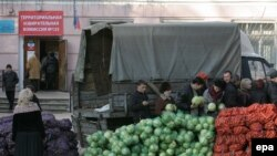 Locals choose agricultural products, which they can buy for a symbolic payment, next to a Donetsk polling station.