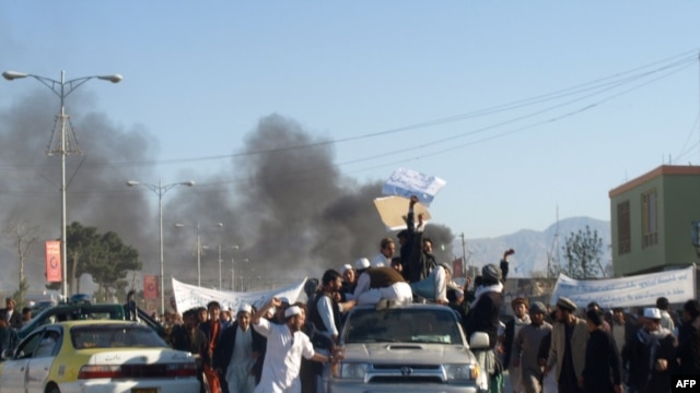 Smoke billows from UN offices in Mazar-e Sharif after protesters attacked the compound following Friday Prayers on April 1, killing seven UN personnel on a day that saw at least five others die in connection with anger over the Koran burning.