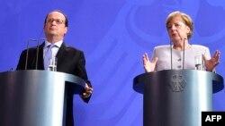 فرانسوا اولاند رئیس جمهور فرانسه و انگیلا مرکل، صدراعظم جرمنی