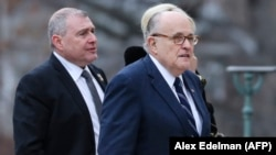 U.S. President Donald Trump's personal lawyer Rudy Giuliani (right) with Soviet-born businessman Lev Parnas at the funeral of President George Bush in Washington in 2018.