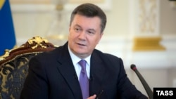 "Ukrainian President Viktor Yanukovych admitted the authorities had made mistakes and promised to show ""more understanding"" for people's needs and aspirations. (file photo)"