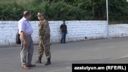 Armenia -- Colonel Artak Budaghian and his lawyer Hayk Alumian in Goris, 11Jul2013