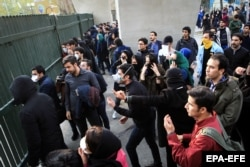 Iranian students clash with riot police during an antigovernment protest at Tehran University on December 30.