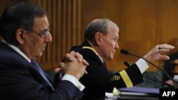 U.S. Secretary of Defense Leon E. Panetta (left) and Chairman of the U.S. Joint Chiefs of Staff General Martin Dempsey testify at a hearing of the Senate Armed Services Committee on Capitol Hill on March 7.