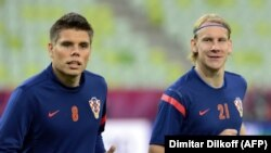Ognjen Vukojevic (left) and Domagoj Vida warm up during a training session at Gdansk Arena in 2012