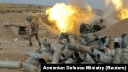 An Armenian soldier fires artillery during the military conflict over the breakaway region of Nagorno-Karabakh on October 4.