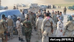 Afghan security forces in the Sanchark district of Sar-e Pul Province (file photo)