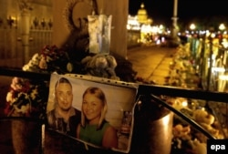 Photos of victims of the Sinai crash are shown next to flowers and candles at Dvortsovaya Square in St. Petersburg, where the doomed flight was headed.