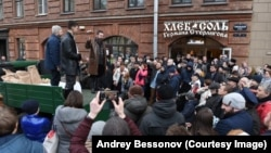 Pictured here standing on a truck in a knee-length, brown-leather jacket at the opening of one of his food stores, Russian businessman German Sterligov has sparked controversy by displaying homophobic signs on his premises.