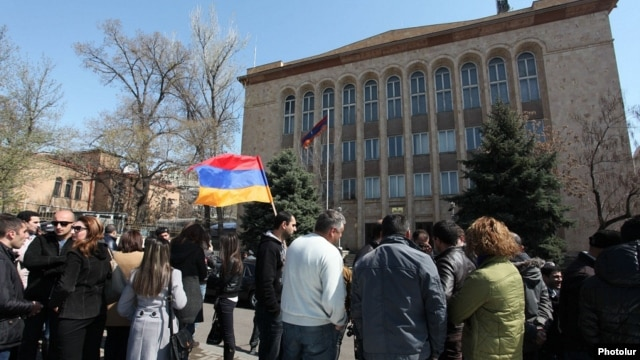Armenia - Activists stand outside the Constitutional Court building in Yerevan, waiting for a ruling on a controversial pension reform, 2Apr2014.