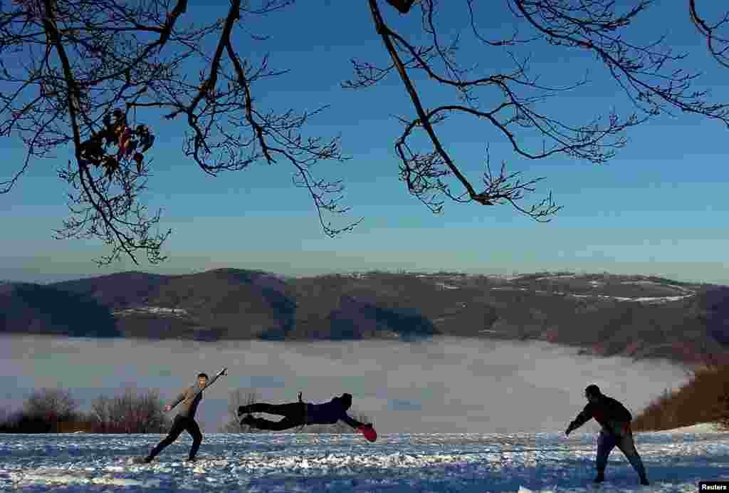People play Frisbee on the Smetovi mountain range near Zenica, Bosnia-Herzegovina. (Reuters/Dado Ruvic)