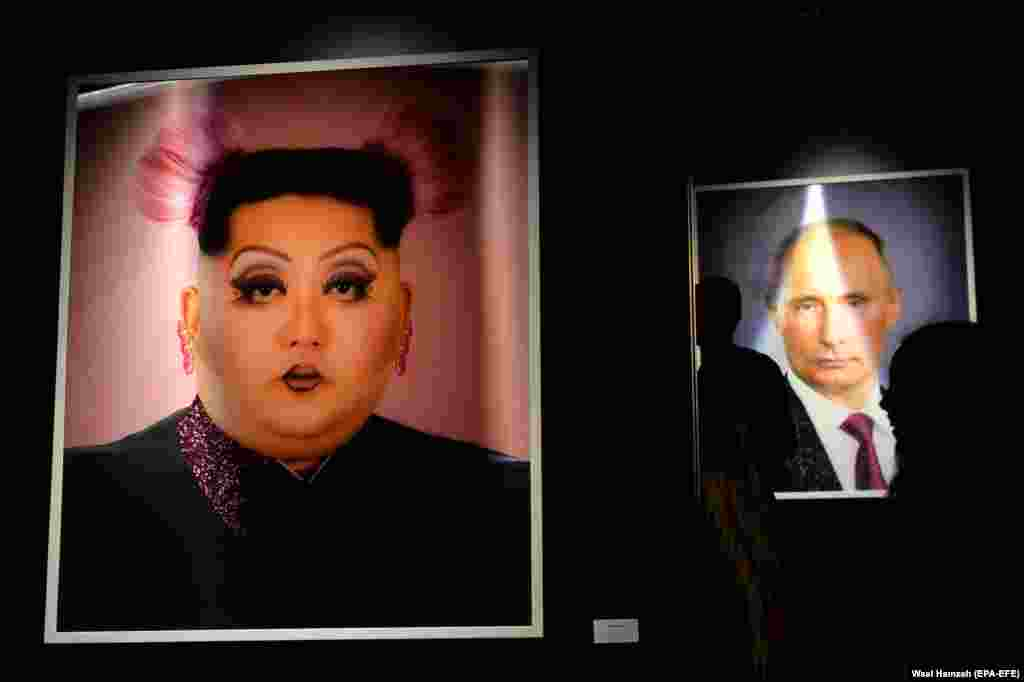 Artwork depicting North Korean leader Kim Jong Un (left) and Russian President Vladimir Putin is displayed at an exhibition called MonuMental by an anonymous artist who goes by the name Saint Hoax at the Dome City Center in Beirut. Saint Hoax is a Syrian artist who depicts political figures and pop culture icons. (EPA-EFE/Wael Hamzeh)​