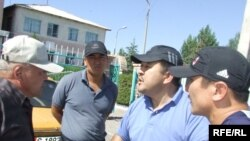 KYrgyz police disperse a peaceful gathering in Balykchy on July 23, detaining dozens of people including lawmakers Mirbek Asanakunov and Kubanychbek Kadyrov.