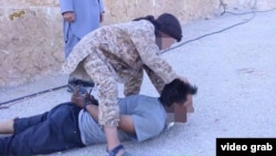 The new video is the first time that Islamic State has documented a child carrying out a beheading.