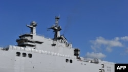 A Mistral class warship ordered by Russia in a French shipyard.