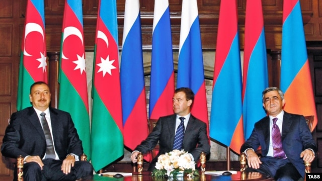 Russian President Dmitry Medvedev (center) sits down with his counterparts Serzh Sarkisian (right) of Armenia and Ilham Aliyev during talks over Nagorno-Karabakh.