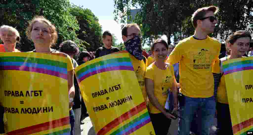 "Activists carry placards saying ""Lesbian and gay rights are human rights"" during the gay-pride parade in the Ukrainian capital."