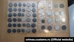 Конфискованные монеты крымской таможней на админгранице Крыма и материковой Украины, январь 2017 год