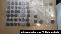 Конфісковані монети кримською митницею на адмінкордоні Криму і материкової України, січень 2017 року