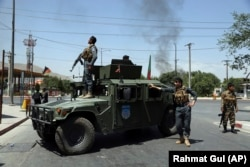 Afghan security forces arrive at the scene of the explosion in Kabul on July 1.