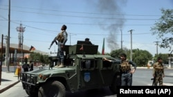 Afghan security forces arrive at the site of a bomb attack in Kabul on July 1.