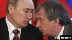Rosneft President Igor Sechin (right) is a close ally of Russian President Vladimir Putin.