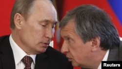 "Russian President Vladimir Putin (left) with his ""right-hand man"" Igor Sechin, who is one of those targeted by the latest round of U.S. sanctions."