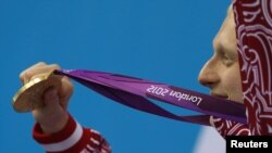 Медал уткан орус спортчусу Лондон олимпиадасы учурунда. 2012-жыл