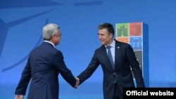 U.K. - NATO General Secretary Anders Fogh Rasmussen greets President Serzh Sarkisian at the NATO summit, 4 Sep2014