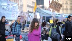 A protester stands on the Puerta del Sol square during a protest against joblessness in Madrid on May 20.