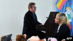 Sir Elton John plays a song for children at an orphanage in Makiyivka.