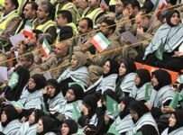 Men and women sitting in segregated seating at a recent meeting of Basij activists in Tehran (Fars)