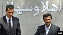 Iranian President Mahmud Ahmadinejad (right) greets his Syrian counterpart Bashar al-Assad in Tehran in August 2009.