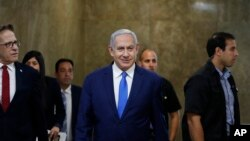 Israel's Prime Minister Benjamin Netanyahu arrives for the weekly cabinet meeting in Jerusalem, Sunday, July 14, 2019. (Ronen Zvulun/Pool Photo via AP)