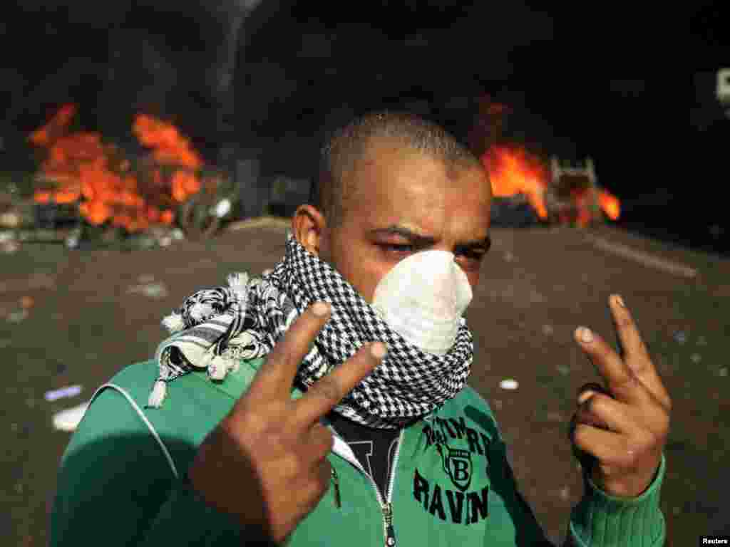 A protester gestures during protests in Cairo on January 28.