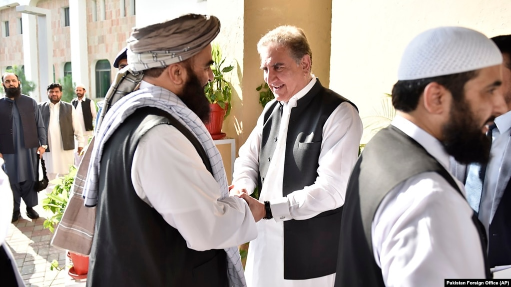 Pakistani Foreign Minister Shah Mehmood Qureshi (center) receives members of the Taliban delegation at the Foreign Office in Islamabad in October 2019.