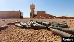 Empty bullet casings are seen at a base in the Raqqa countryside used by Kurdish fighters after Islamic State fighters said they took control of the area.