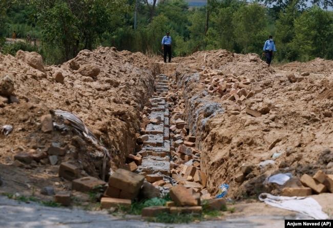 Police officers guard the site of the proposed temple in Islamabad on July 7.