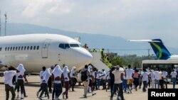 Часть мигрантов, которых вернули в Республику Гаити