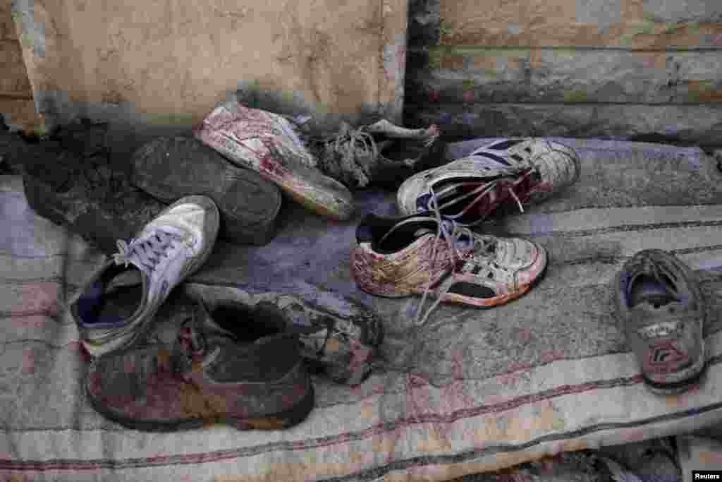 Bloodstained shoes after Syrian government forces fired missiles at a busy marketplace in Douma on October 30
