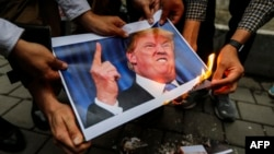 Iranians burn an image of U.S. President Donald Trump during a demonstration outside the former U.S. Embassy in Tehran on May 9.