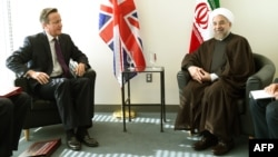 British Prime Minister David Cameron (left) meets with Iranian President Hassan Rohani at UN headquarters in New York on September 24.